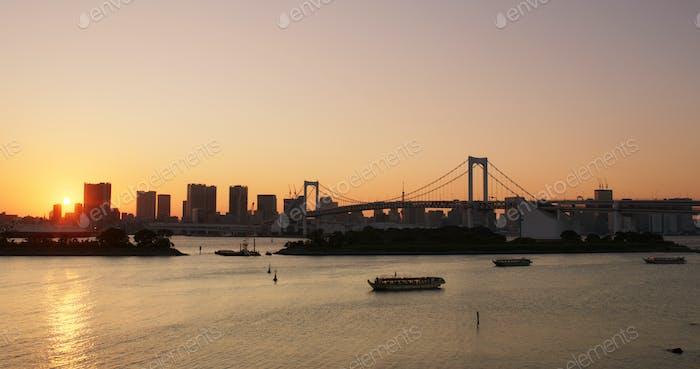 Tokyo, Japan, 01 July 2019: Odaiba city landscape at sunset