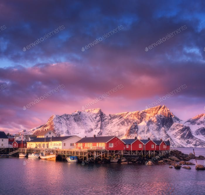 Beautiful fishing village with boats at sunrise