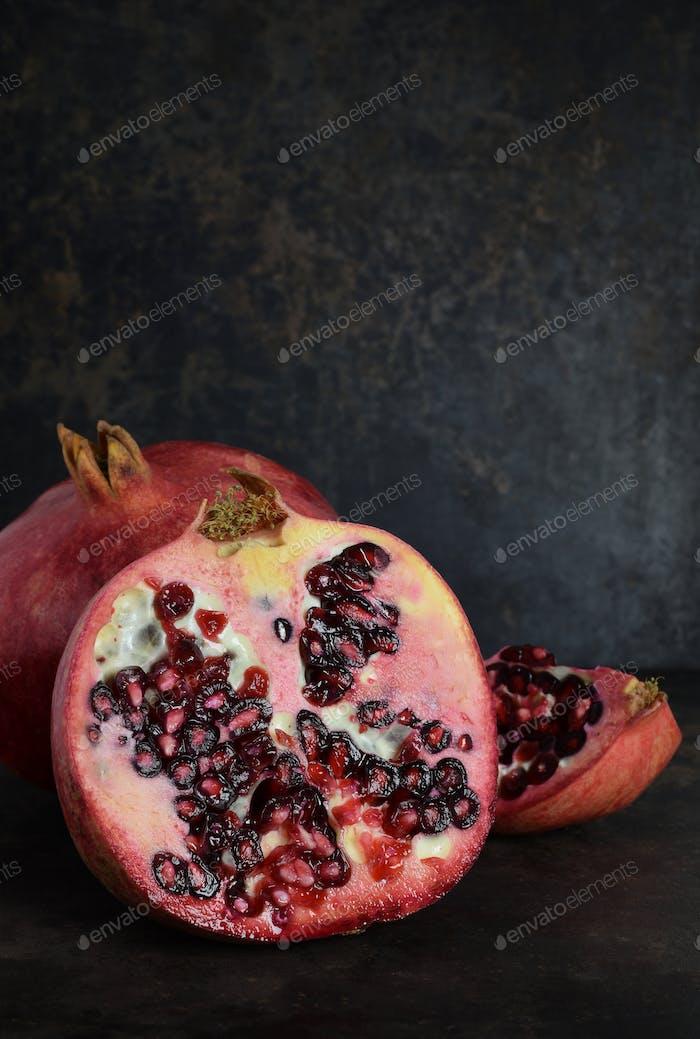 Pomegranate Fruits on a Dark Background