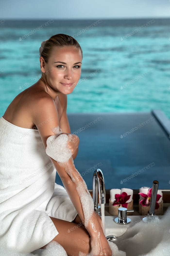 Pretty woman taking bath