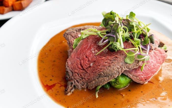 Sliced beef steak on plate