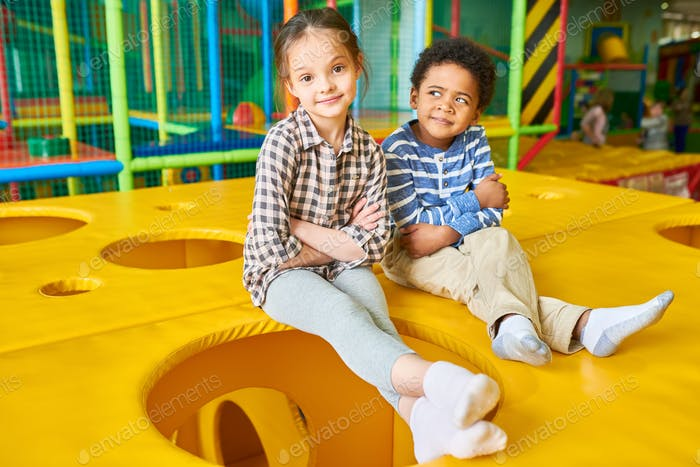 Children Posing in Play Area