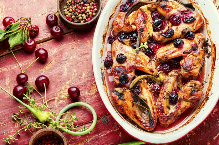 Chicken wings with cherries.