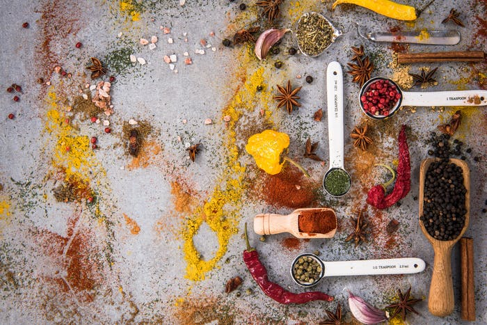 Spices and herbs on concrete slate