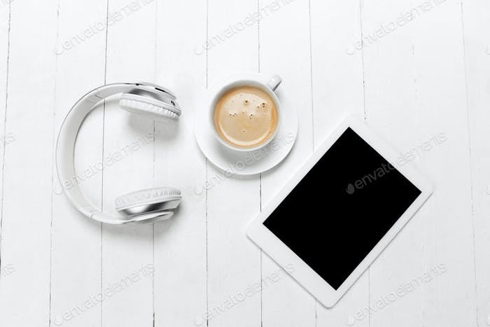 Gadgets and coffee. Monochrome stylish composition in white color. Top view, flat lay