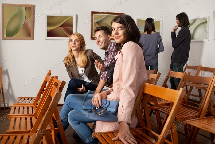 happy friends at a photography exhibition