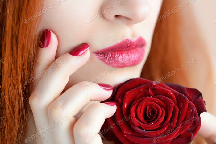 Portrait with red rose flower. Dark red lips and nails. Beautifu
