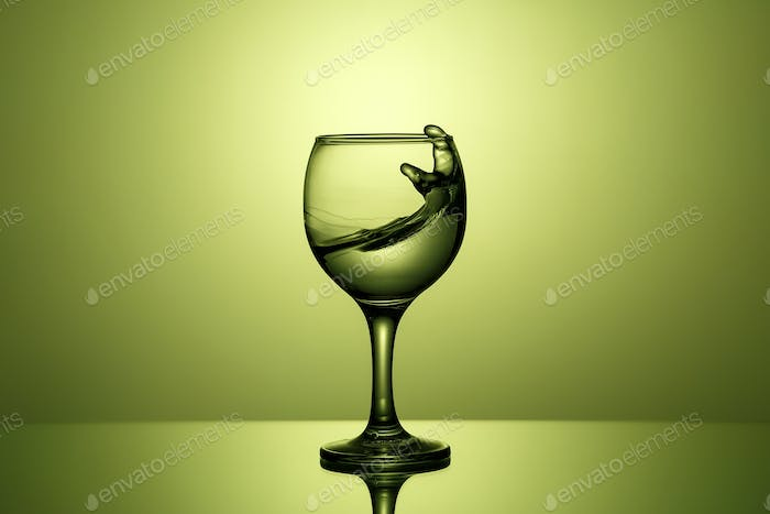 Splash of clear water in a glass