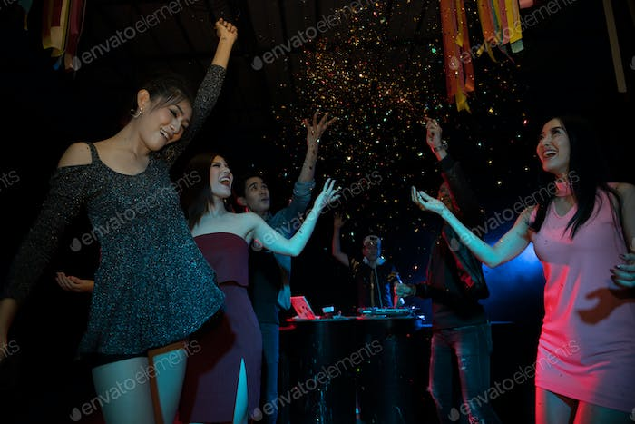 Party young people group dancing in night club