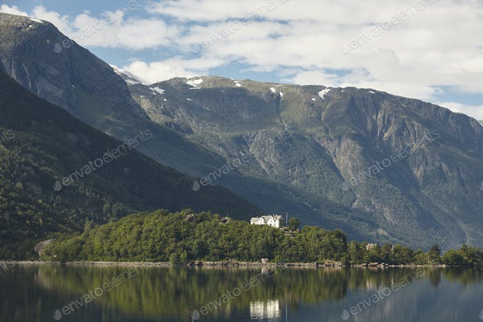 Norwegian fjord landscape with mountains and houses. Sorfjorden. Norway. Horizontal
