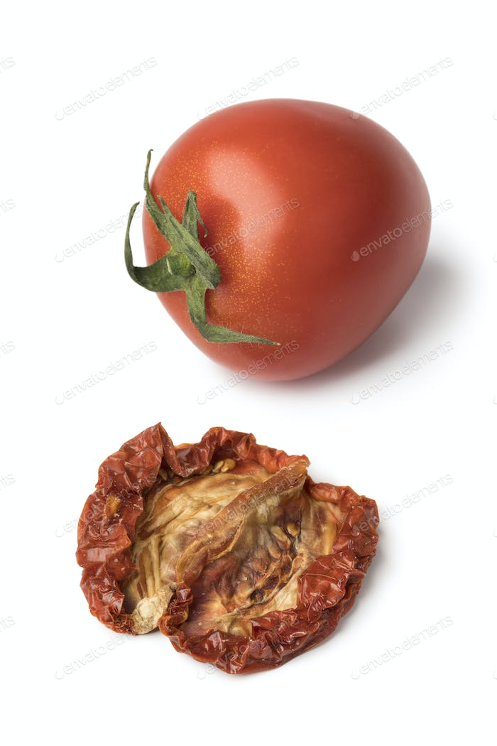 Single fresh and dried tomato