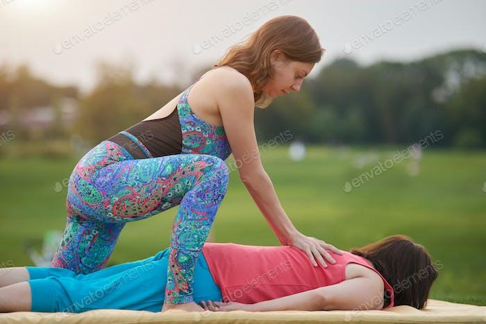 Massaging shoulder blades, side view.