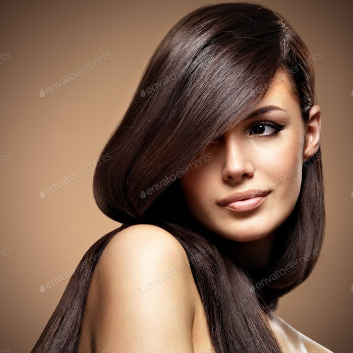 Beautiful young woman with long straight brown hair.