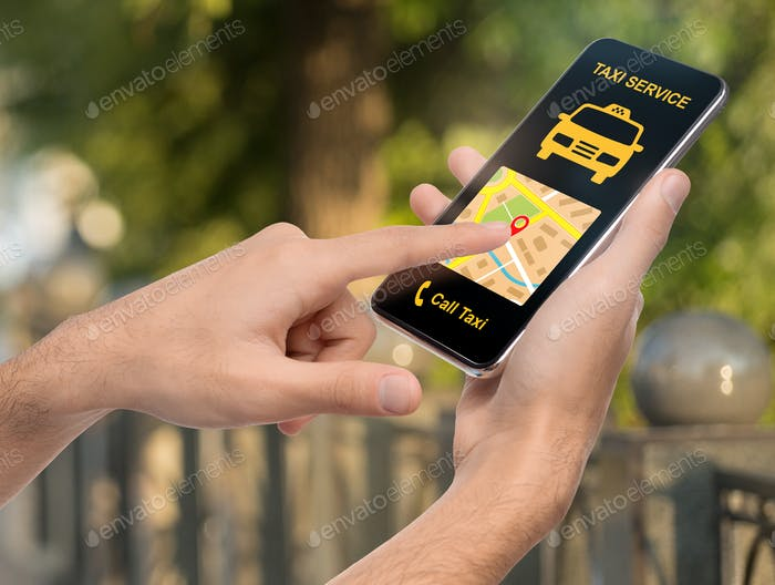 Man holding smartphone with taxi app interface