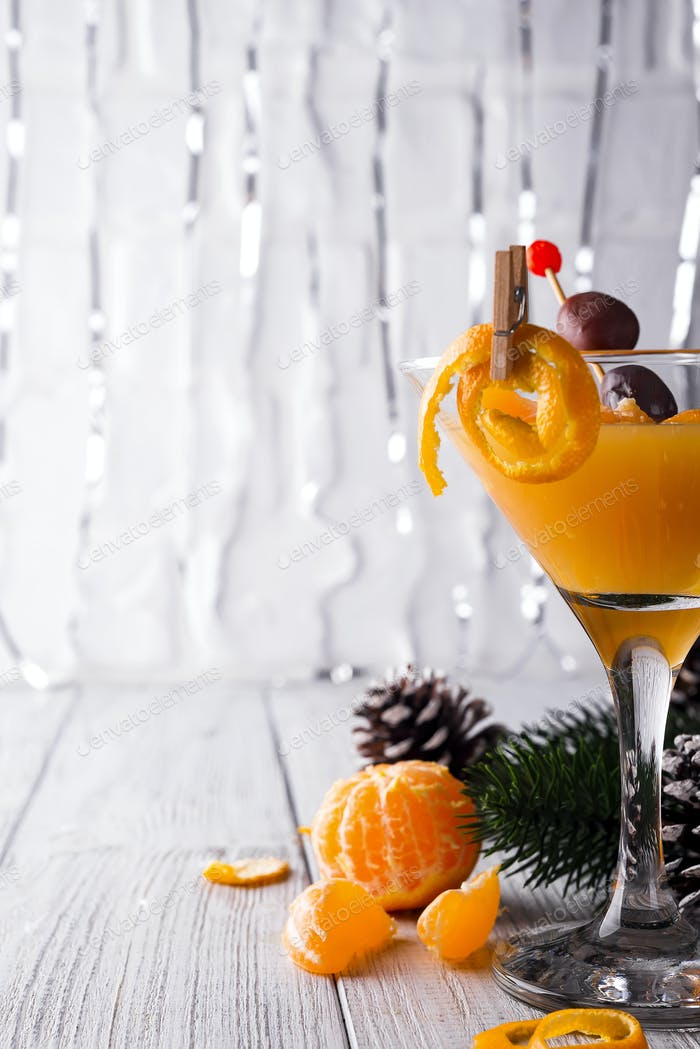 Citrus martini in a glass of New Year