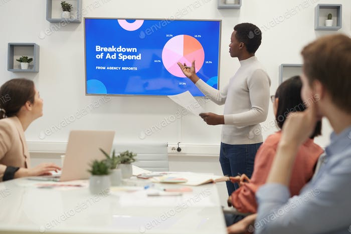 African Businessman Giving Presentation on Marketing