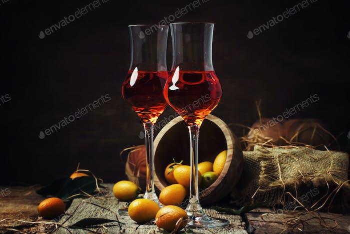 Traditional greek kumquat liqueur in shot glass