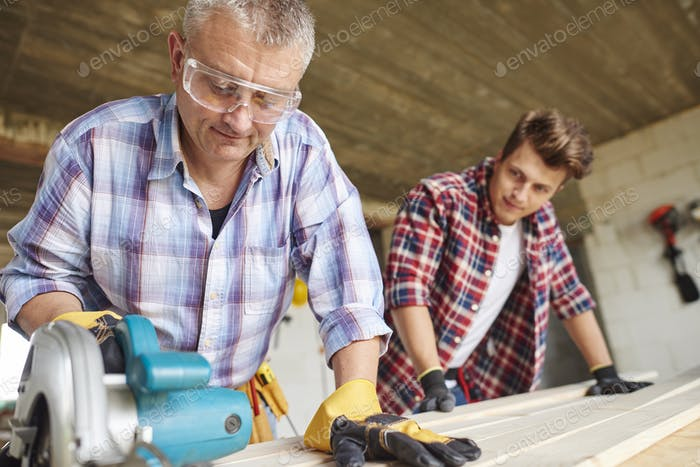 Experienced worker is clamping the wood