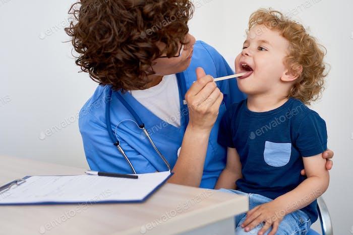 Nurse Examining Little Boy