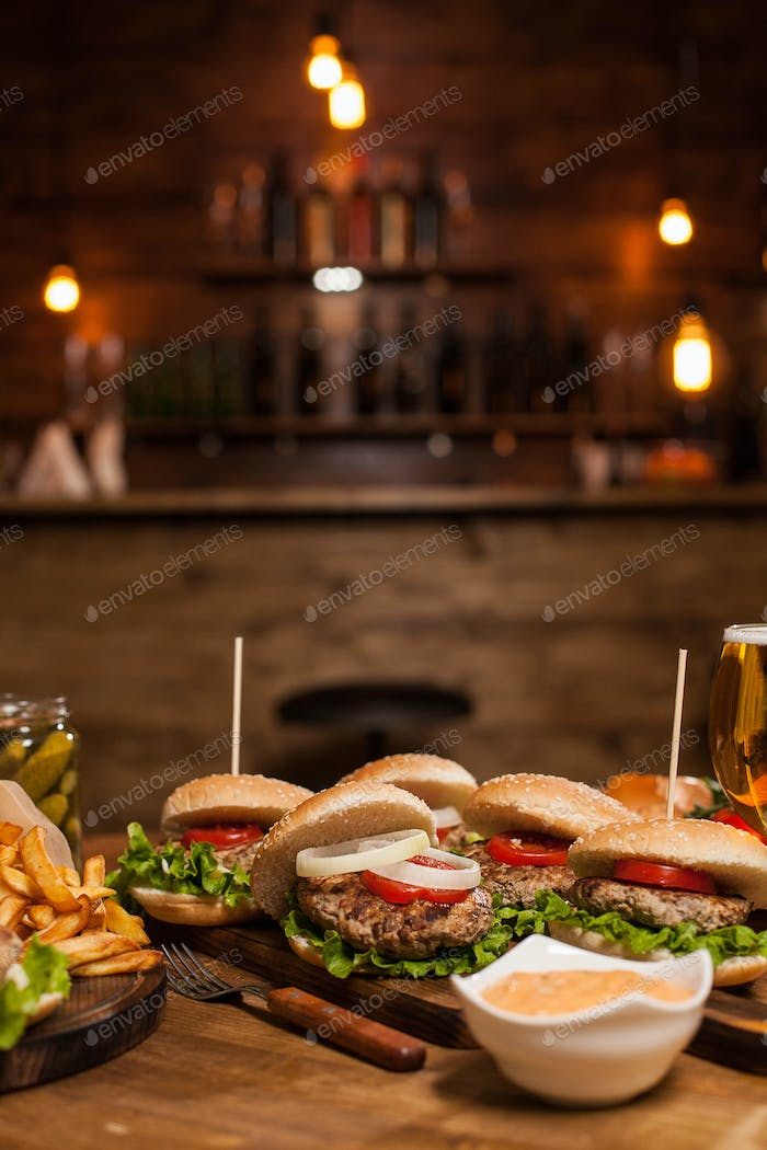 Vintage restaurant table full of delicious burgers