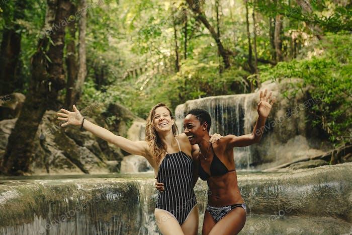 Friends having fun at a waterfall
