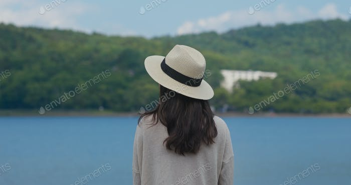 Woman look around the lake