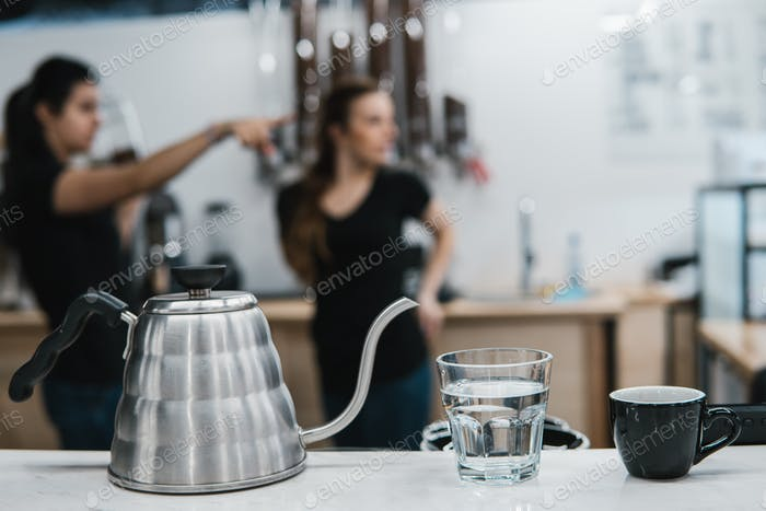 cup with coffee near a glass of water and tea