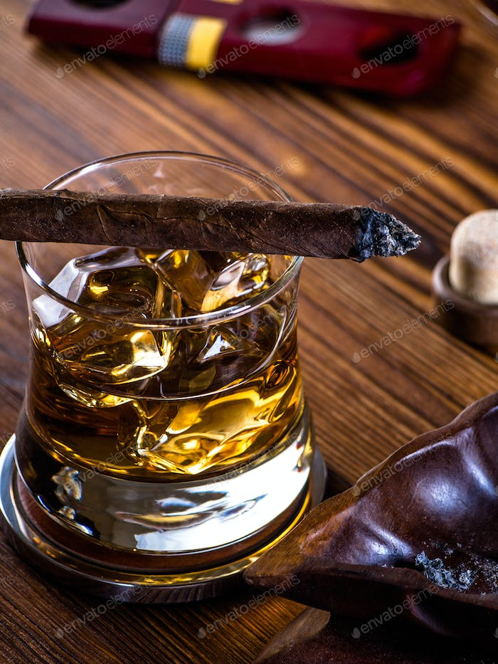 Whisky on the rocks and a cigar