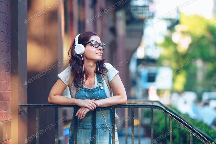 Young girl in headphones in New York