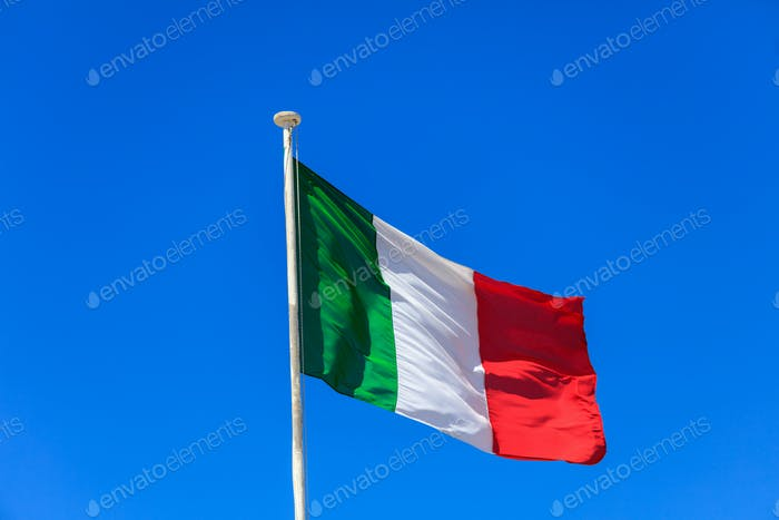 Italy flag. Italian flag on a pole waving on blue sky background