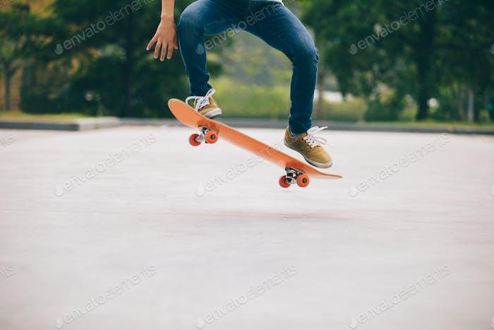 Skateboarder doing a trick ollie
