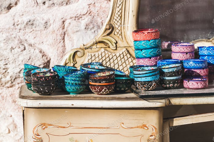 Stack of handmade multicolor Turkish dishes painted with oriental ornaments. Vintage plates