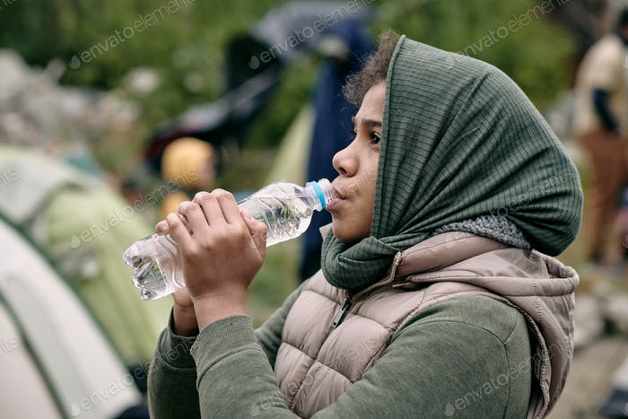 Migrant Girl Drinking Water