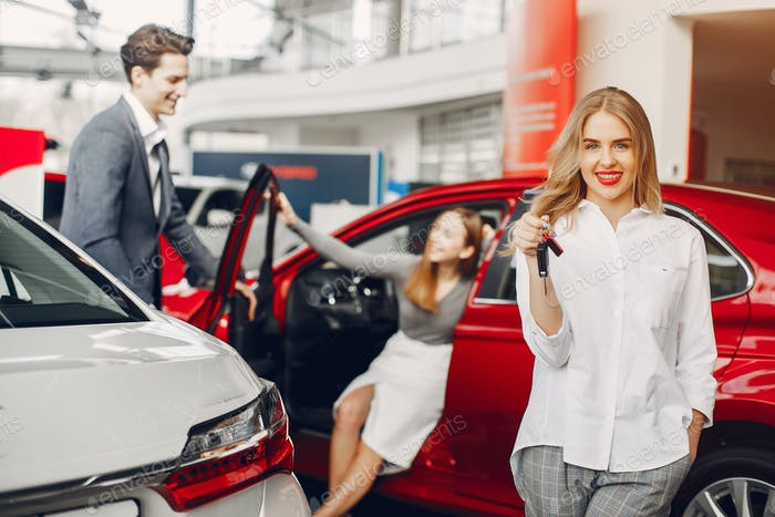 Two stylish woman in a car salon