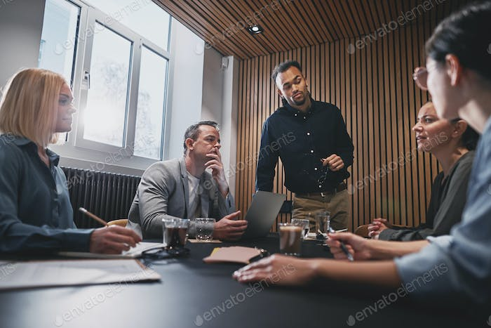Diverse businesspeople discussing work during a boardroom meeting