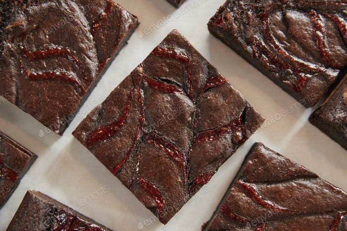 Display Of Freshly Baked Raspberry Swirl Brownies In Coffee Shop