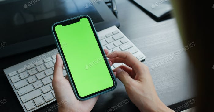Woman use of cellphone with green screen