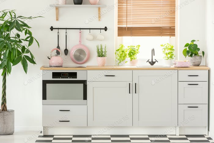 Pastel Pink Pan And Kettle In A Beautiful Kitchen Interior With