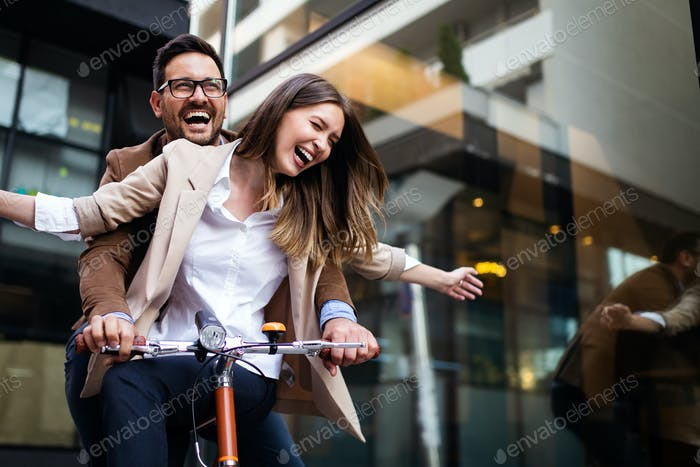 Happy smiling young couple having fun in the city