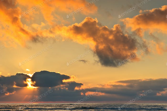 sunrise at sea with clouds