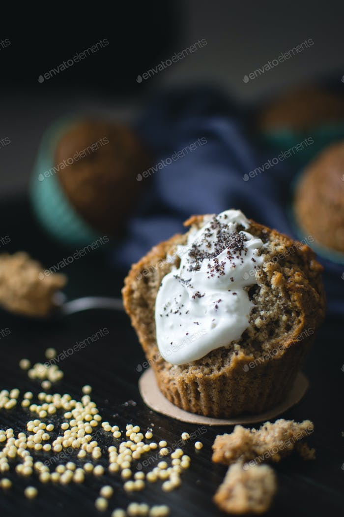 Poppyseed muffin with cream and millet grains