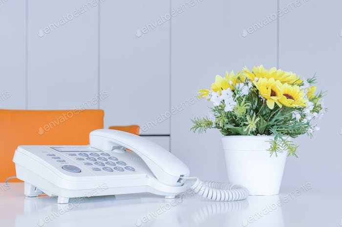 soft focus on telephone devices at office desk with light effect,communication technology concept