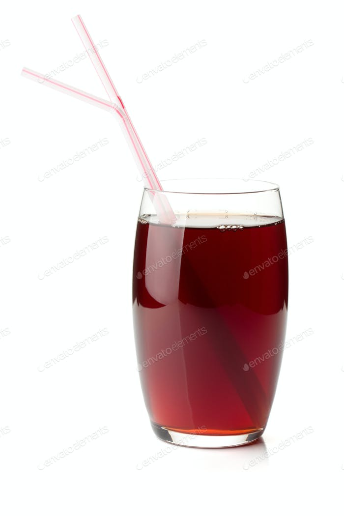 Pomegranate juice in a glass with two drinking straws