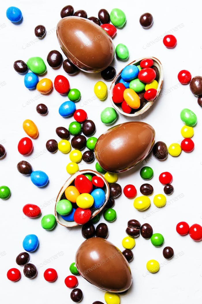 Easter composition with chocolate eggs and colorful candy
