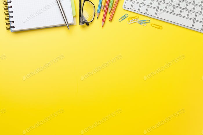 Office yellow backdrop with supplies and computer