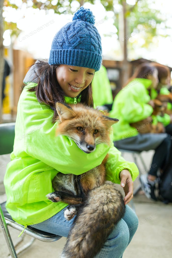 Woman hug with lovely wild fox