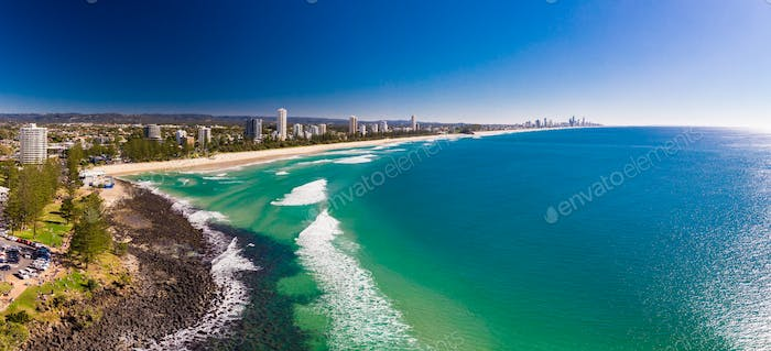 Aerial view of Burleigh Heads - a famous surfing beach suburb on