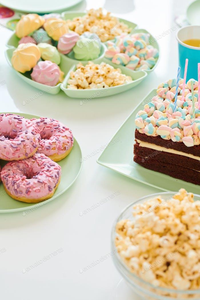 Birthday desserts on served table