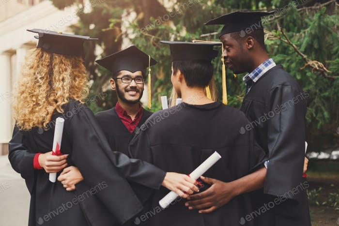 Graduates having a group hug