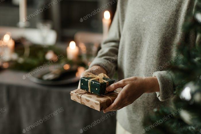 Woman Holding Small Christmas Presents